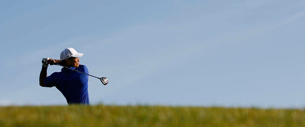 Tiger Woods finished birdie-birdie for a two-under 68 to safely make the cut.