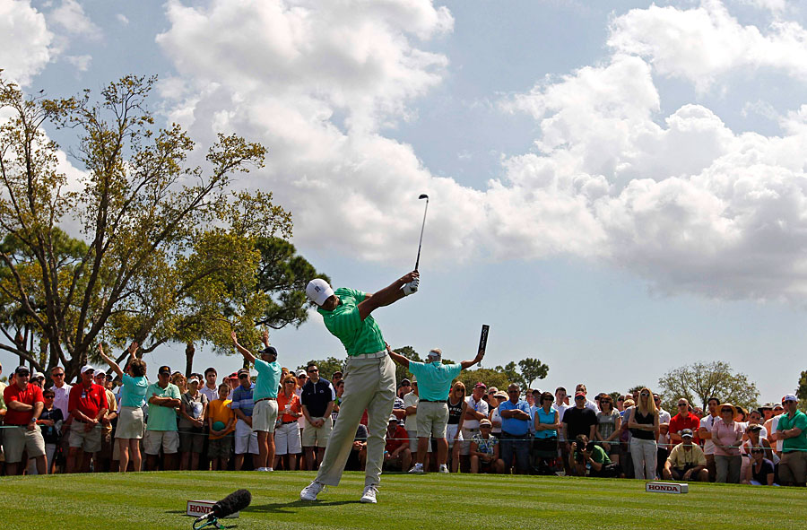 Tiger Woods made three birdies and two bogeys for a one-under 69.