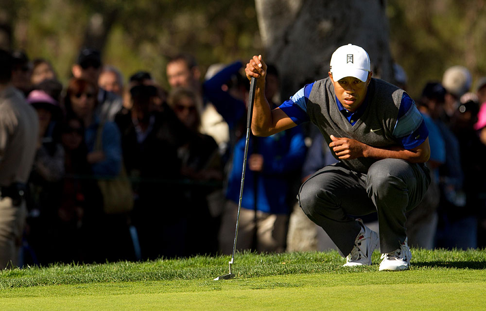 Tiger Woods shot a five-under 67 to grab a three-shot lead over Matt Kuchar and K.J. Choi heading into the weekend.