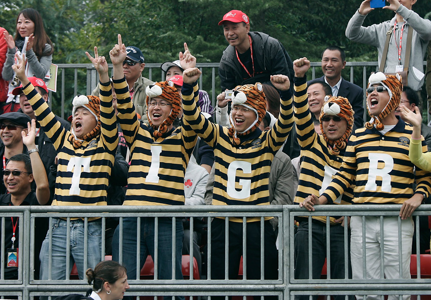 These fans made it a team effort to cheer on Woods at the 2010 HSBC in Shanghai.