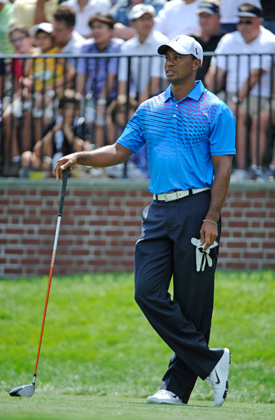 3. Tiger Woods                       Year after year, tournament after tournament, Tiger always looks fantastic. He's made subtle changes to the cut of his wardrobe over the years, but the result is always flawless. He mastered the solid-color polo/trouser combination long ago, but lately, I like the fact that Tiger has been experimenting with some fun modern prints like the one pictured. He's always perfectly coordinated from top to toe, and with his athletic build and premium Nike TW ensembles to choose from, it's pretty much impossible for him to look bad.