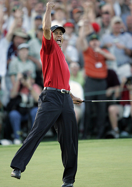Woods won his fourth Masters title by sinking a 15-foot birdie putt on the first playoff hole against Chris DiMarco in 2005.