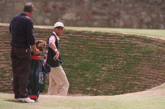 A 19-year-old Tiger Woods enters the Road Hole bunker at the 1995 British Open at St. Andrews. Woods finished T68 in the tournament. Woods won his first British Open five years later when the Open returned to St. Andrews in 2000.