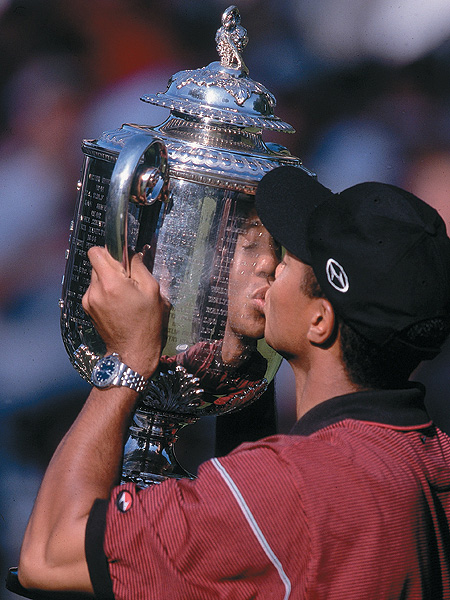 1999                                                                     You never forget your first kiss, and after holding off a charging 19-year-old named Sergio Garcia, Woods hoisted the Wannamaker Trophy for the first time as the winner of the PGA Championship.