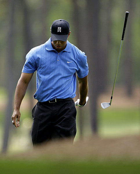 Woods threw a club after hitting his approach shot to 18 during the second round of the 2009 Masters.