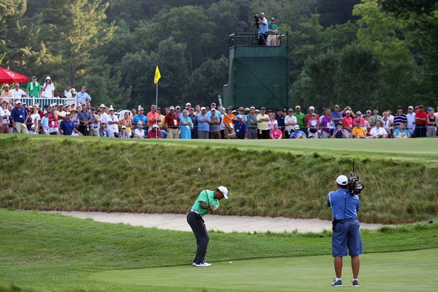 Tiger Woods's first trip to the Greenbrier was a short one. Woods missed the cut by one stroke on Friday.