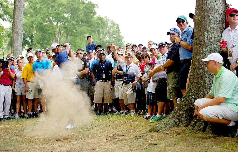 Tiger Woods blasted out of trouble on the second hole at the PGA Championship. Woods would go on to miss the cut.