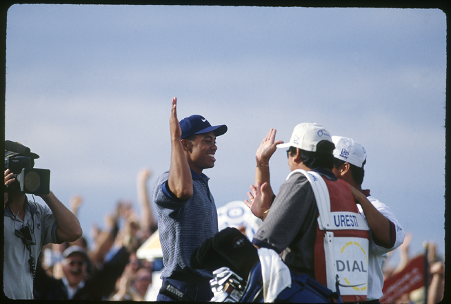 Tiger showed much better high-five execution than he would exhibit with caddie Stevie Williams after holing his chip on 16 on Sunday at the 2005 Masters.