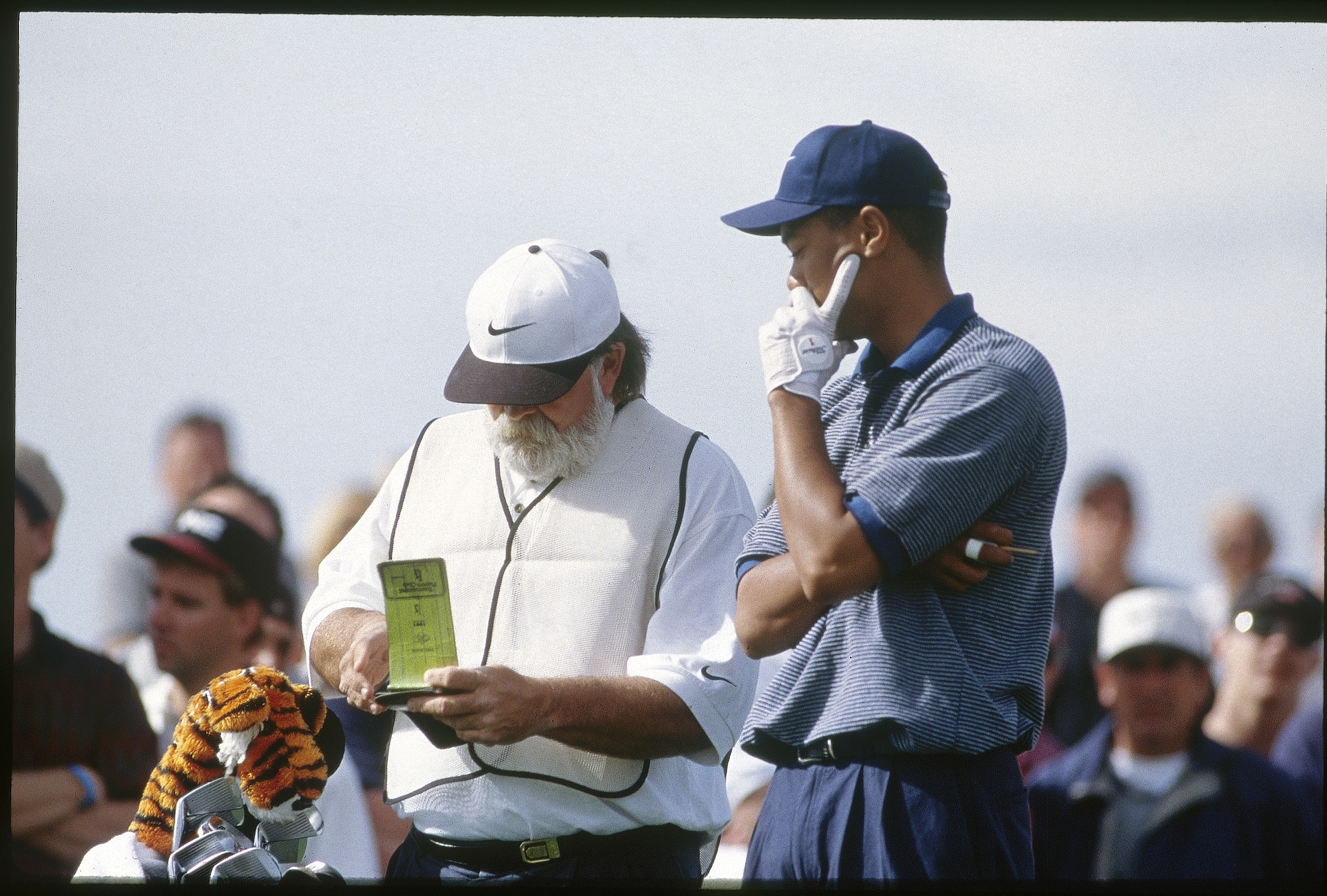 Fluff gives the yardage book one more look. He's a long-time Deadhead, which explains the Jerry Garcia beard