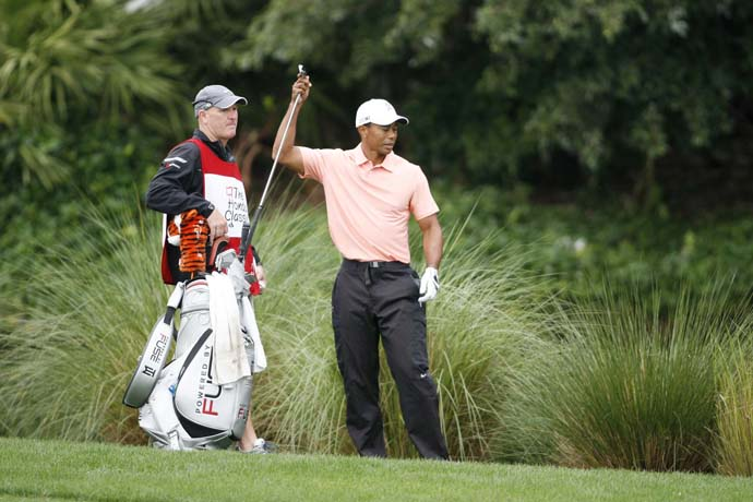 After a chat with LaCava, Tiger decides to hit 9-iron.
