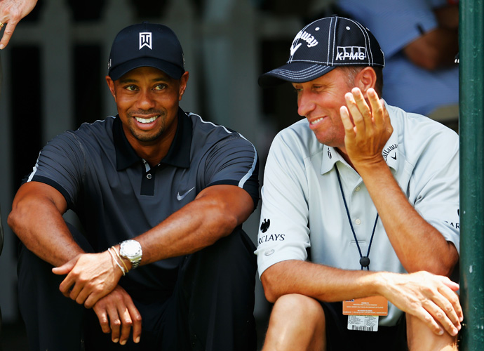 """Tiger Woods also chatted with Phil Mickelson's caddie, Jim """"Bones"""" Mackay, before playing a practice round."""