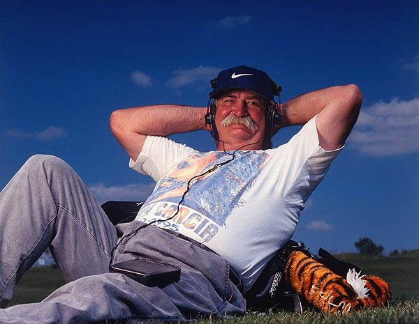 Mike (Fluff) Cowan                     When he started carrying Tiger's bag in 1996, Fluff became a celebrity himself. That didn't please his boss, and Cowan was replaced by Steve Williams in early 1999.