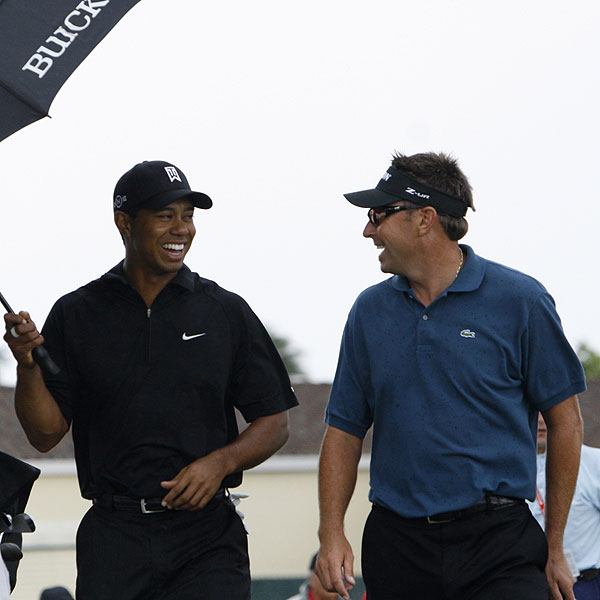 Woods and Robert Allenby, who was tied for the lead, shared a laugh at No. 11.
