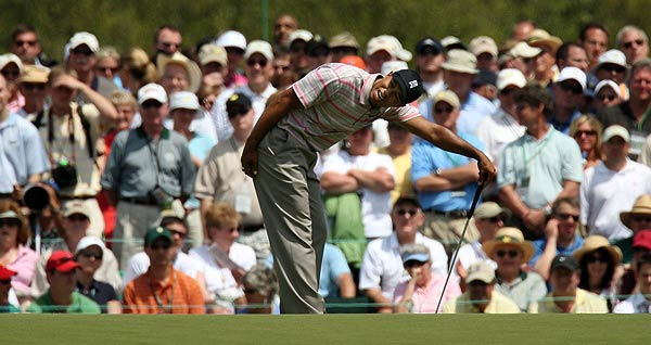 Woods could barely stand missing a birdie putt on the ninth hole Thursday.