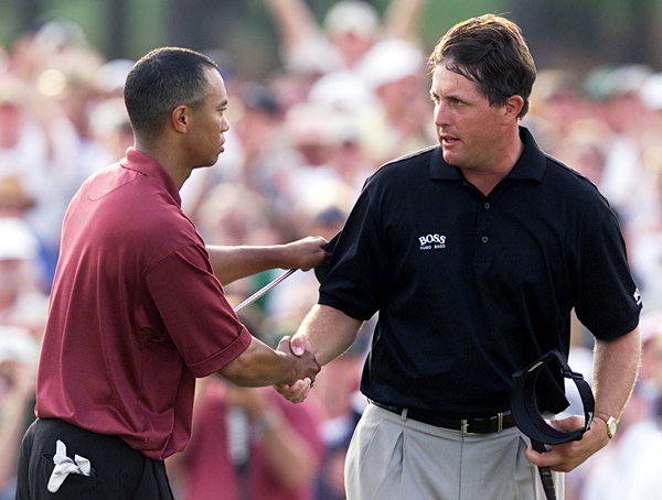 """Phil Mickelson                       2001 Masters, Augusta National Golf Club                       Started: One behind Woods                       Finished: Third after a 70                       Woods' score: 68                       Key stat: Longer off the tee, Woods hit eight more                       greens and four more fairways than Mickelson for the                       week to become the first player to hold all four major                       titles at once.                       Where it all went wrong: After pulling within a                       stroke with a birdie on 15, Mickelson yanked his 7-iron                       tee shot onto the wrong tier on 16 and three-putted.                       Telling comment: """"The thing about Tiger is that he's                       the only leader that you don't have hope that he will                       falter,"""" Mickelson said when Woods won the Masters                       again the following year."""
