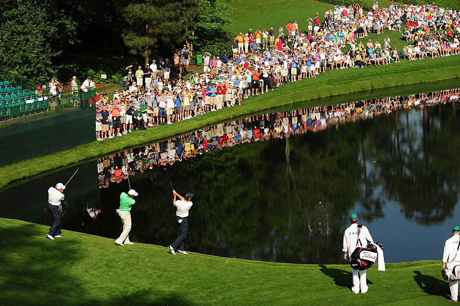 Mark O'Meara, Tiger Woods and Sean O'Hair participated in a unique Masters practice round tradition on Wednesday: skipping balls across the pond on the par-3 16th hole.