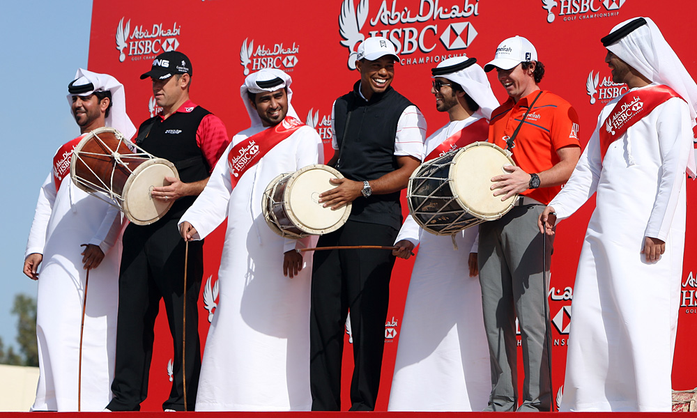 Woods participated in a publicity event for the tournament with McIlroy, right, and Lee Westwood.