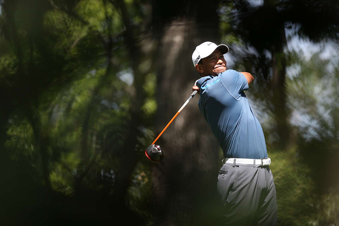 Woods was assessed a two-shot penalty before the start of play because of an improper drop during the second round.