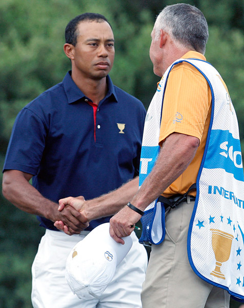 The much-anticipated match that pitted Tiger Woods and Steve Stricker against Adam Scott and K.J. Choi began with a brief handshake between Woods and his ex-caddie Steve Williams.