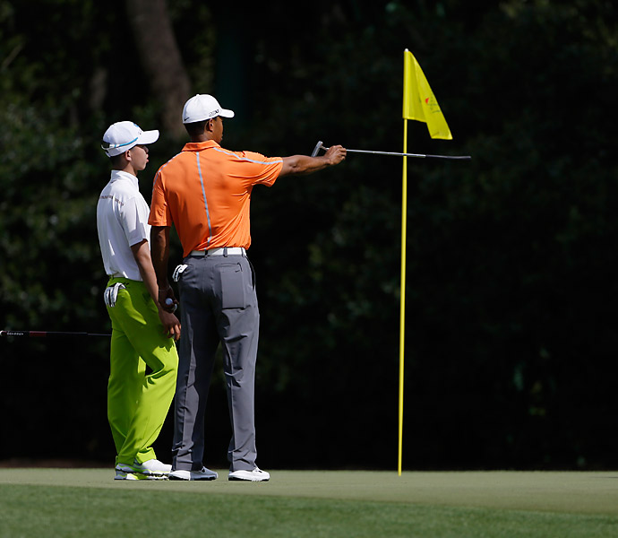 Woods played with 14-year-old Tianlang Guan, who will become the youngest golfer ever to play in the Masters this week.