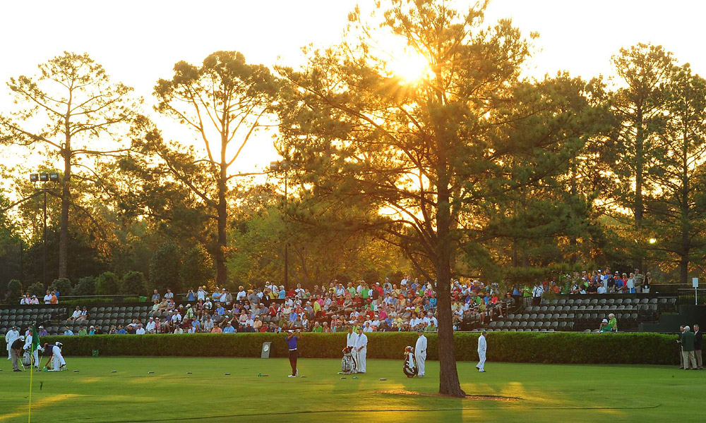 Fans were out early to see Tiger's early morning practice session.