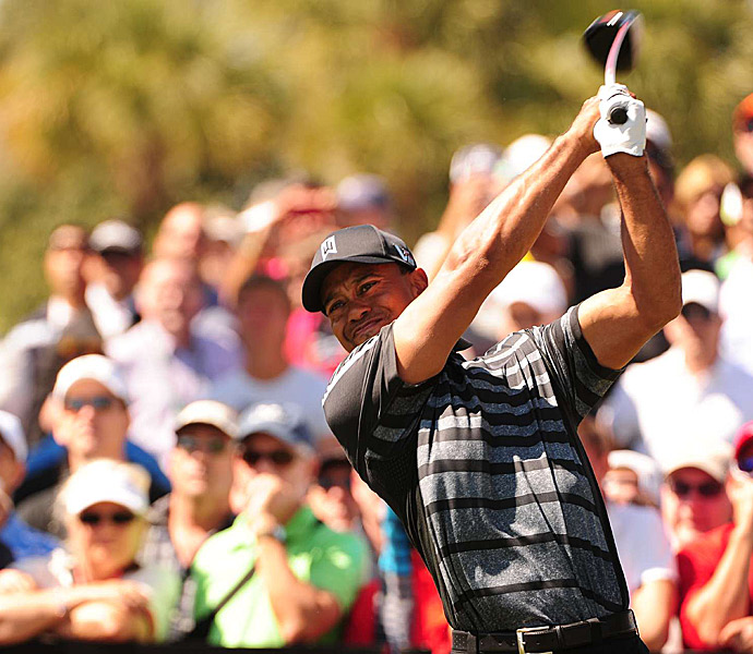 Woods was on fire in round 1, shooting a six-under 66 to get into a five-way tie for the lead.