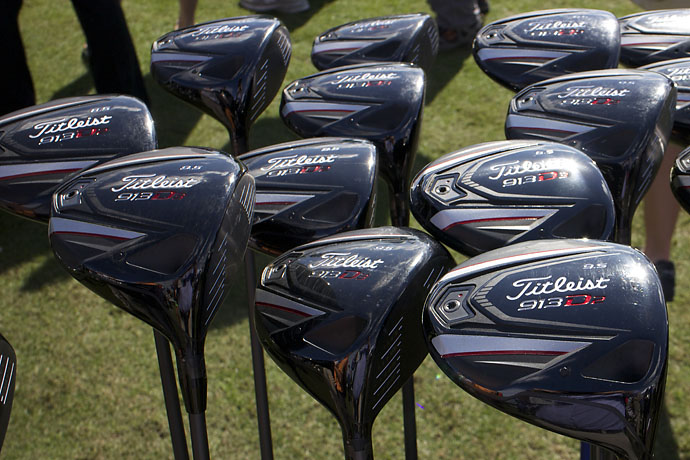 At Demo Day, PGA professionals walk around a giant circular driving range and stop in at any tent to grab a club and start testing it, like these Titleist drivers.