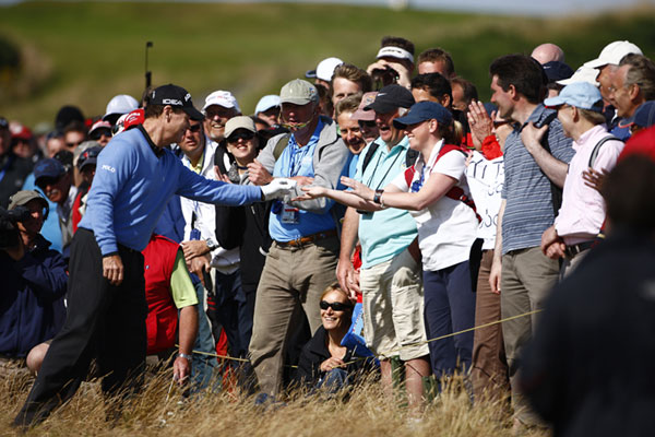 Watson thanked this fan for helping his lie, after the ball bounced off of her on the 12th.