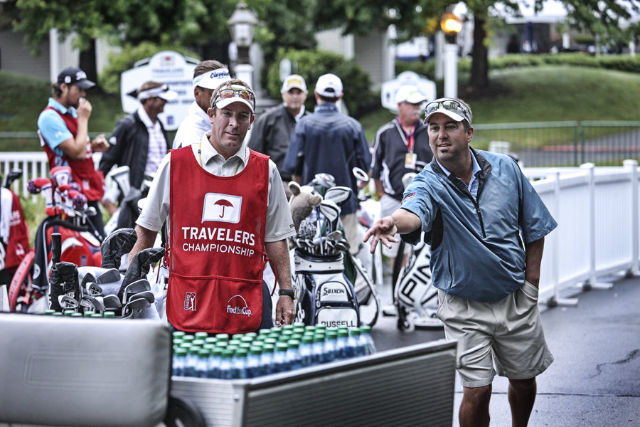 Among the more creative ways the caddies waited out a rain delay: a makeshift game of ring toss.                                              More Behind-the-Scenes Stories                       -- MORFIT: A week with struggling Tour pro James Driscoll                       -- BASTABLE: Meet the Traveler's do-it-all tournament director                       -- BARRETT: Superintendent Tom DeGrandi has squeegeed it all