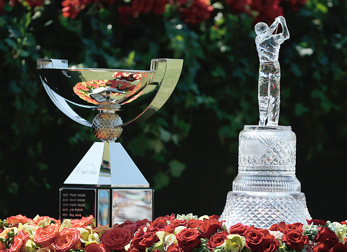 There are two trophies up for grabs this week, the FedEx Cup (left) and the Tour Championship trophy.