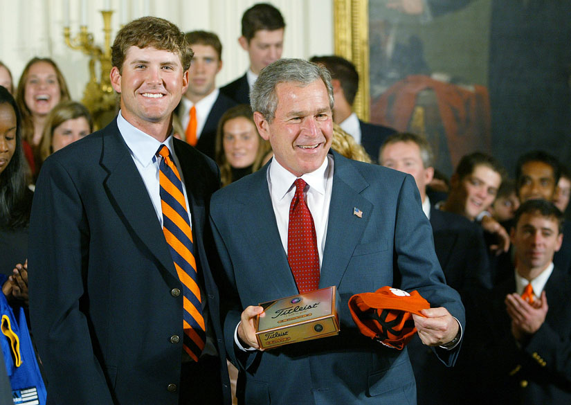 In 2003, D.J. Trahan, then the captain of the Clemson golf team, gave President Bush a cap and golf balls. Bush met with several reigning NCAA champions at an event in the East Room.