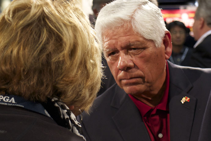 Lee Trevino deep in conversation with a fan Wednesday at the Yamaha Golf-Car booth at the Orlando Convention Center.