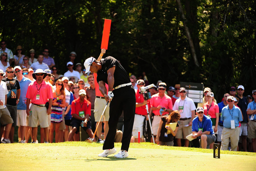 Tiger Woods shot a four-under 68 and avoided back-to-back missed cuts.