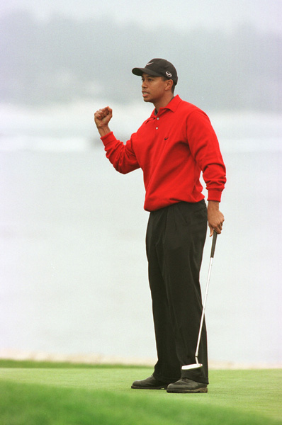 Tiger Woods' Hole-Out For Eagle in Miracle Comeback at 2000 AT&T                       	Seven strokes back with seven holes to play? Not a problem. Not for Tiger Woods, whose pitching wedge from 97 yards on the 15th hole Monday landed just long, then sucked back into the cup, part of an epic charge that turned Matt Gogel, the one-time leader, into a footnote in the annals of the AT&T.