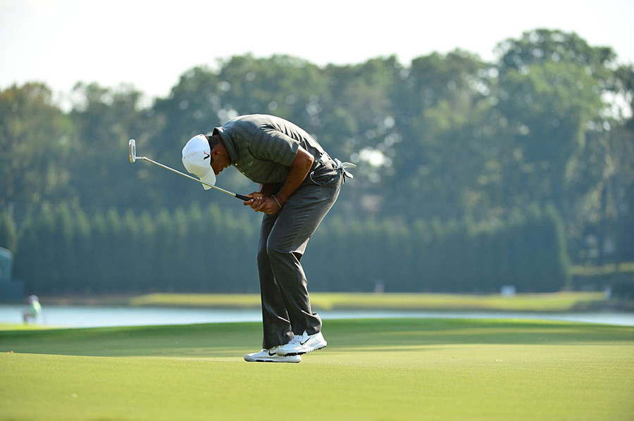Woods missed several short putts for birdie on Saturday.