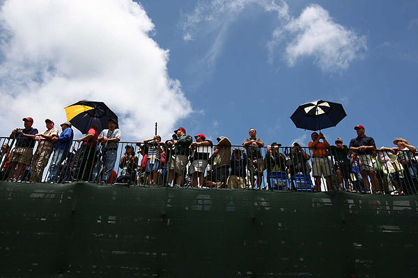 "Friday at the U.S. Open                                              Bethpage Black was a different place on Friday as fans were using their umbrellas to block the sun, not the rain.                                               function fbs_click() {u=""http://www.golf.com/golf/gallery/article/0,28242,1905392,00.html"";t=document.title;window.open('http://www.facebook.com/sharer.php?u='+encodeURIComponent(u)+'&t='+encodeURIComponent(t),'sharer','toolbar=0,status=0,width=626,height=436');return false;} html .fb_share_link { padding:2px 0 0 20px; height:16px; background:url(http://b.static.ak.fbcdn.net/images/share/facebook_share_icon.gif?8:26981) no-repeat top left; }Share on Facebook                                                                                                                                                                                        addthis_pub             = 'golf';                                               addthis_logo            = 'http://s9.addthis.com/custom/golf/golf_logo.jpg';                                              var addthis_offset_top = -155;                                              addthis_logo_color      = '555555';                                              addthis_brand           = 'Golf.com';                                              addthis_options         = 'email, facebook, twitter, digg, delicious, myspace, google, reddit, live, more'                                                                                                                                            Share"