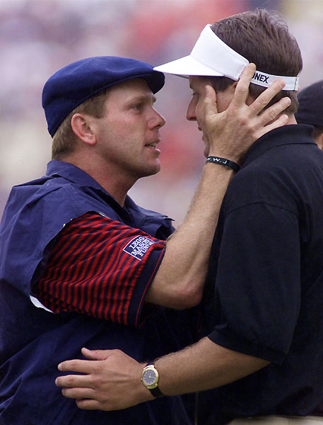 8. 1999 Payne Stewart vs. Phil Mickelson 279-280The first ever Open played at Pinehurst No. 2 featured a bewitching setup, but the great names ascended and fell back before leaving just the beknickered one and beeper-wearing father-to-be Phil Mickelson with a chance to win at the final hole. When Mickleson's 25-foot birdie putt stopped short, Stewart had to hole a 15-footer for par to win. The gum-chomping Stewart stepped up and rammed home the putt. He punched the air emphatically, then bear-hugged caddie Mike Hicks. That October, a plane crash took Stewart's life, but nothing could dim the memory of one of the game's greatest showmen winning an unforgettable duel.