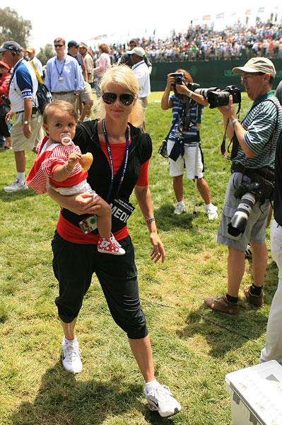 Wife, Elin, and daughter, Sam Alexis, followed Woods on his way to victory.