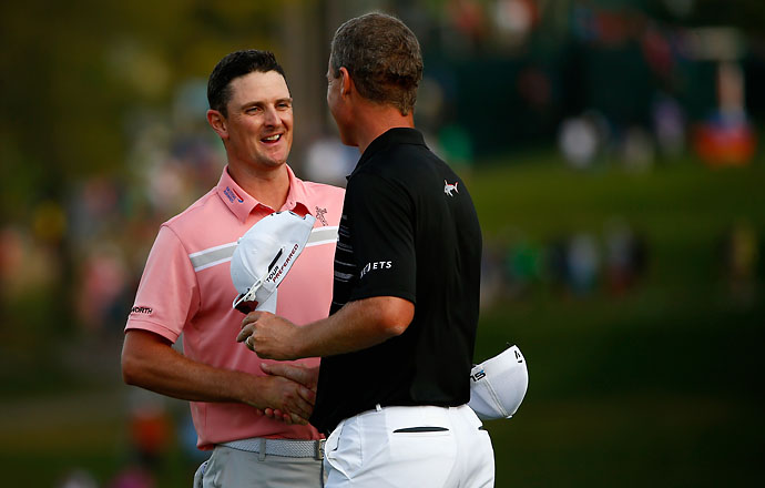 Justin Rose of England shakes hands with winner John Senden following the final round. The reigning U.S. Open champion started the day in the Top 5, but a five bogeys on Sunday dropped him to T8.