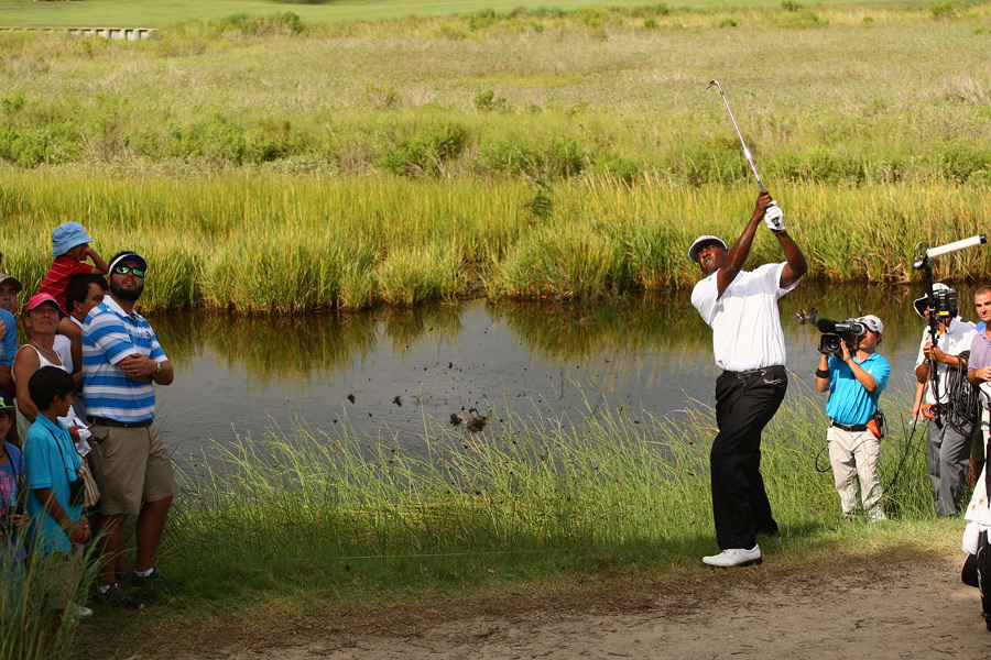 Vijay Singh birdied No. 7 to grab a share of the lead before play was called.
