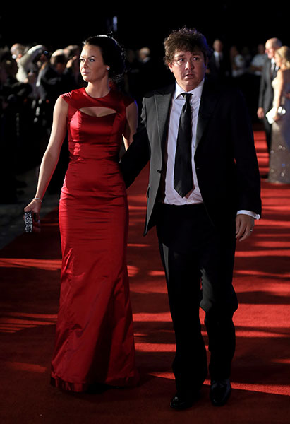 Amanda Dufner shows off a red dress on the red carpet at the 2012 Ryder Cup.