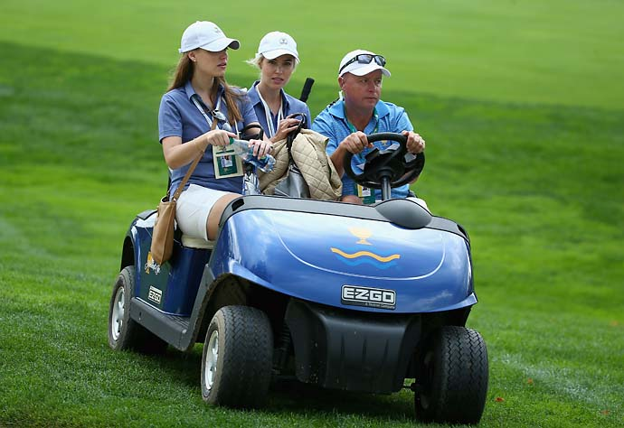 Nieke Coetzee [left], Lisa-Marie Sterne and caddie captain Greg Hearmon watch the action on the seventth hole during the Day Two foursome matches.