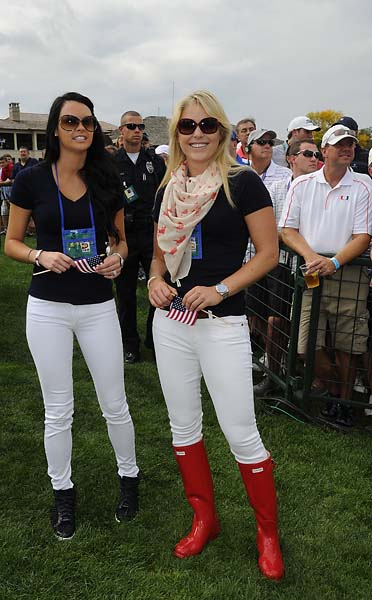 Amanda Dufner and Lindsey Vonn follow the play of the U.S. Team during the Day One fourball matches of the Presidents Cup.