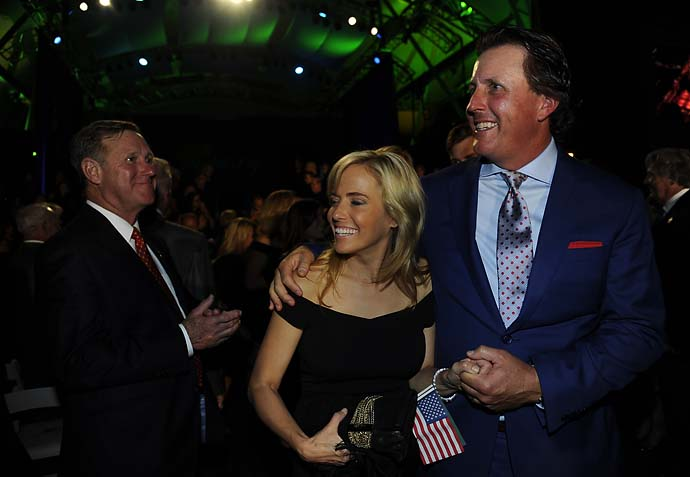 Phil Mickelson of the U.S. Team and his wife Amy Mickelson during the opening ceremonies for the Presidents Cup.