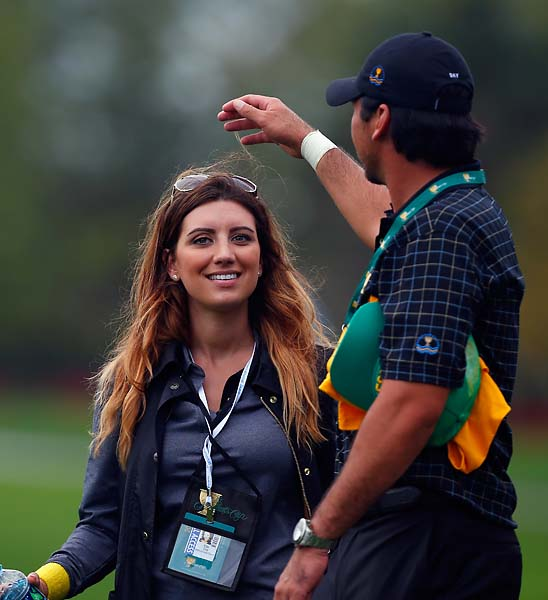 Ellie Day talks with her husband, Jason, during the Day Four singles matches at the Presidents Cup.
