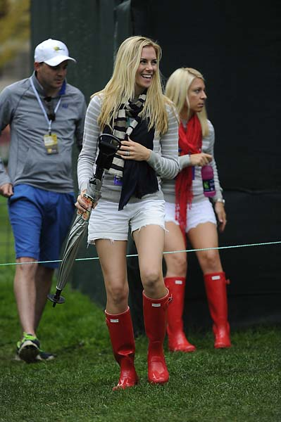 Mandy Snedeker and Dowd Simpson follow play during the Day Three four-ball matches.