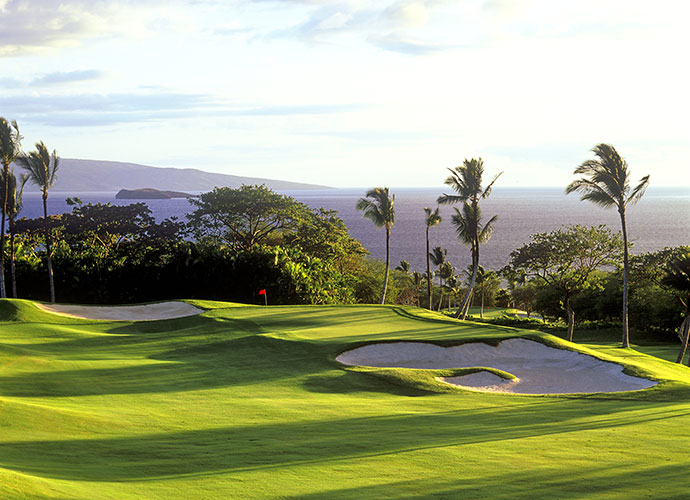 Most Couples-Friendly Course                       Gazing at the downhill plunge that greets golfers at the first tee of Wailea Golf Club's Emerald course, you can feel the stress melt away. The entire Robert Trent Jones Jr. creation delights at every turn. There are more dramatic elevation changes and fewer forced carries than on its tougher Gold sibling, along with ocean panoramas, shallower bunkers, plenty of run in the wide fairways, and beautiful floral displays, such as the profusion of colors left of the 11th tee. While hardly a pushover—the course has a 135 slope from the tips—Wailea Emerald is the perfect Maui spot to entertain yourself, your significant other and your best friends.