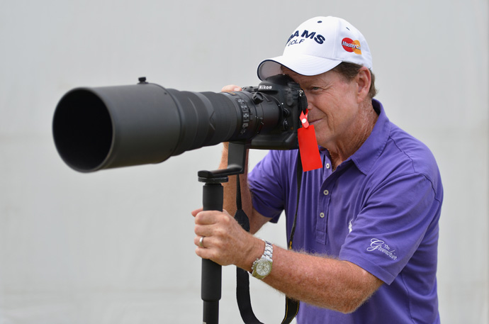 Tom Watson put down his clubs and snapped a few pictures during his practice round.