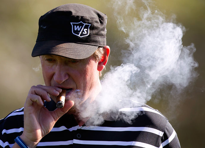 Wayne Gretzky, hockey great and future father-in-law to Dustin Johnson, smokes a cigar on the way to the second green at Michael Jordan's 2011 celebrity golf tournament at Shadow Creek in Las Vegas.