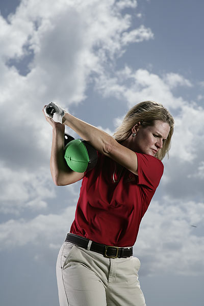 Keep your elbows together with the clubhead pointed parallel to the target line for a powerful top position.